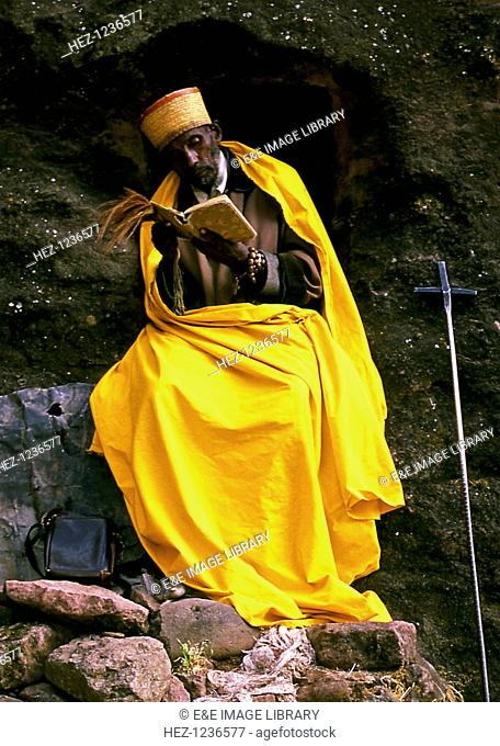 Monk, Lalibela, Ethiopia. The town of Lalibela in northern Ethiopia is one of the holiest sites to Ethiopian Christians. It is noted for its eleven rock-hewn...