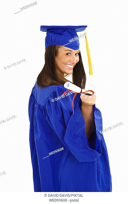 41eb0130f7d A female caucasian in navy blue graduation gown and very excited She is on  a white