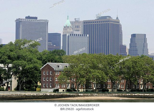 USA, United States of America, New York City: Governors Island, Fort Jay and Castle Williams in the East River. Skyline of South Manhattan