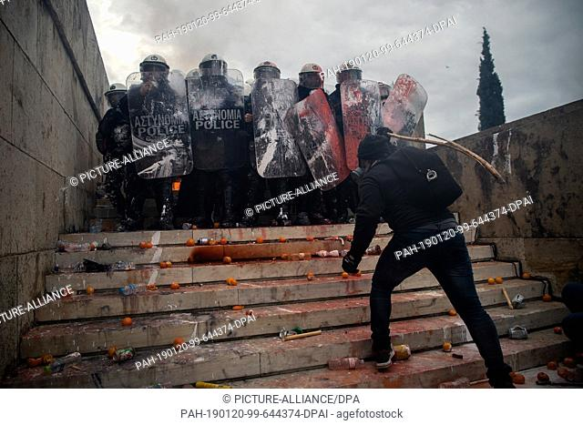 20 January 2019, Greece, Athen: A participant in a demonstration against the planned ratification of Macedonia's name change in northern Macedonia threatens...