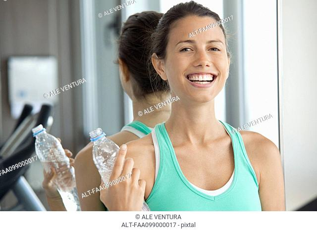 Woman relaxing with bottle of water