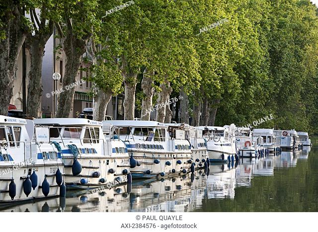 Boats moored along the shoreline of the Canal du Midi; France