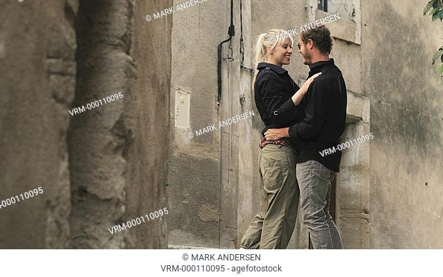 couple kissing on a European street