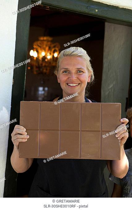 Woman showing chocolate bar