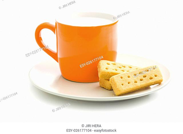 shortbread fingers with milk on white background