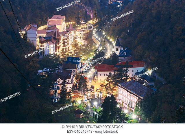 Borjomi, Samtskhe-Javakheti, Georgia. Aerial View Borjomi Cityscape, Hotel House And Central Park In Autumn October Evening Night In Night Illuminations Lights...