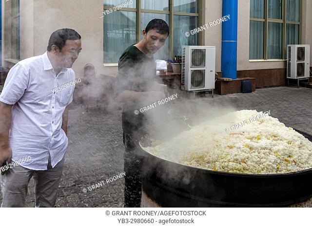 A Man Cooks Rice For PLOV (The National Dish) At The Central Asian Plov Centre, Tashkent, Uzbekistan