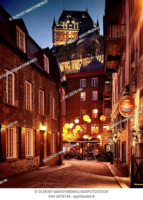 Q-De-Sac Resto-Pub, Q de Sac restaurant pub by night with colorful lanterns and la Chasse-Galerie boutique at Rue du Cul de Sac street in old Quebec City