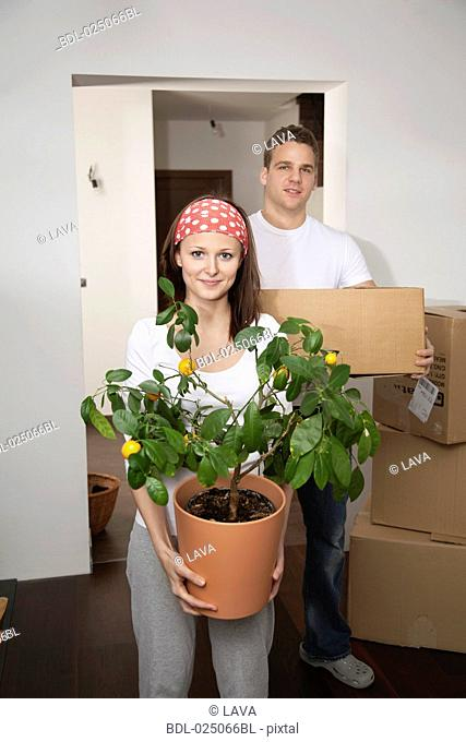 portrait of young couple moving into new flat