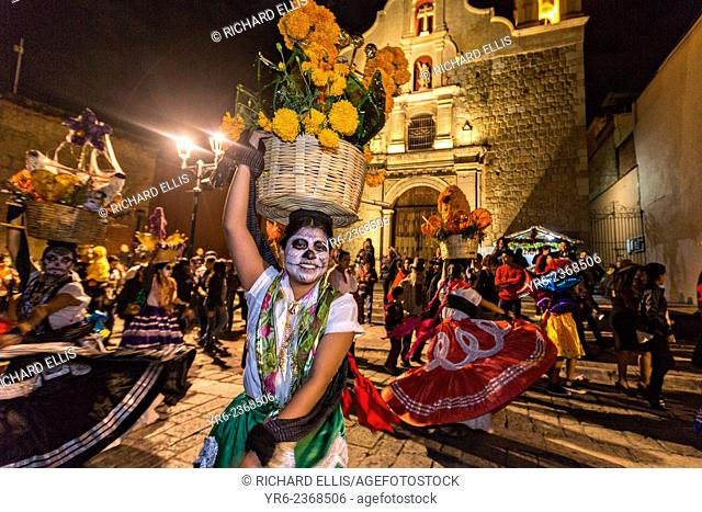 Costumed dancers at a Comparsa, or parade during the Day of the Dead Festival known in spanish as D'a de Muertos on October 31, 2014 in Oaxaca, Mexico