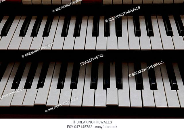 Close up old vintage double keyboard of organ