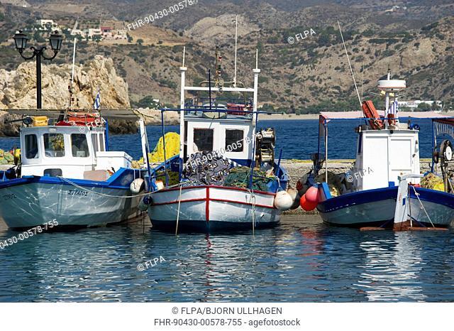 Fishing boats in harbour, Pigadia, Karpathos, Dodecanese Islands, Aegean Sea, Greece, July