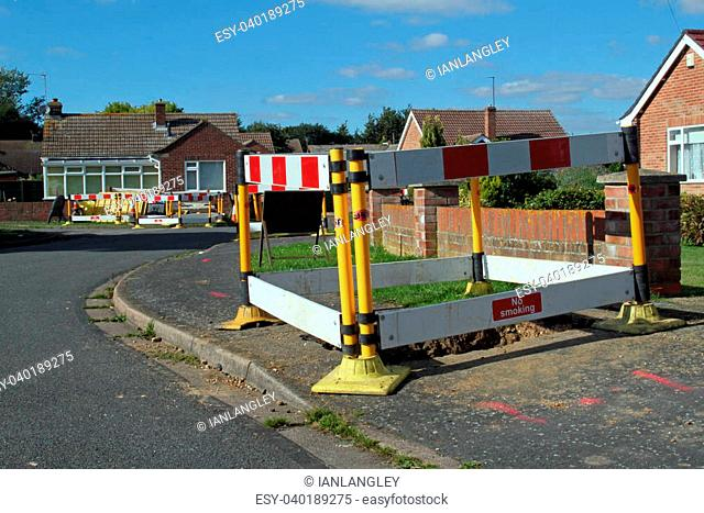 Road work warning signs and barriers in a street in England
