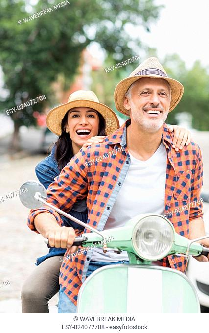 Happy couple on moped