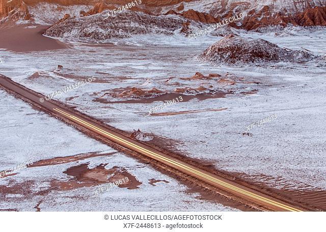 Road across Valle de la Luna (Valley of the Moon ) near San Pedro de Atacama, and salt deposited on the ground, Atacama desert. Region de Antofagasta