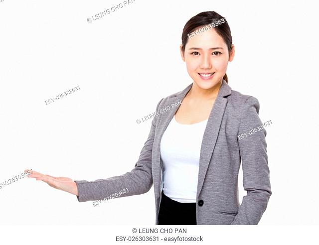 Young Businesswoman with hand showing something