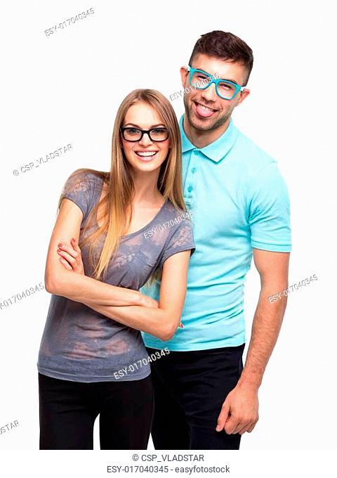 Beautiful young happy couple, man and woman looking at camera, i
