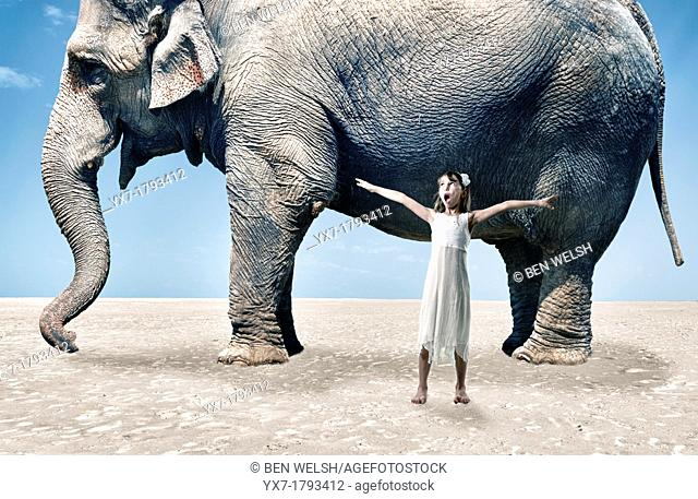 Girl next to a big elephant