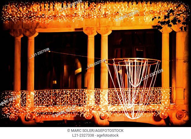 Christmas lights on Casa Fuster. Designed by architect Lluís Domènech i Montaner. Barcelona, Catalonia, Spain