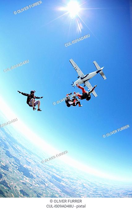 Skydivers free falling above Leutkirch, Bavaria, Germany