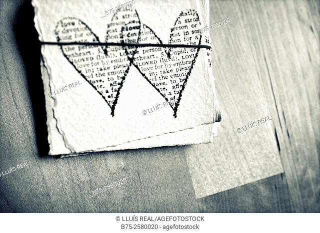 Hearts stamped rubber stamp in a pieces of paper