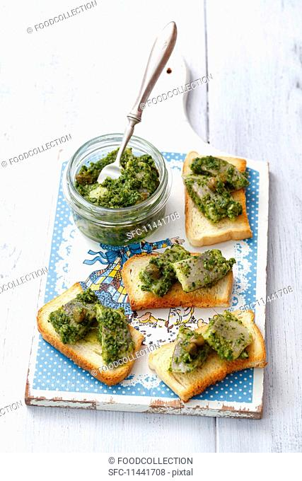 Toast topped with herring in salsa verde