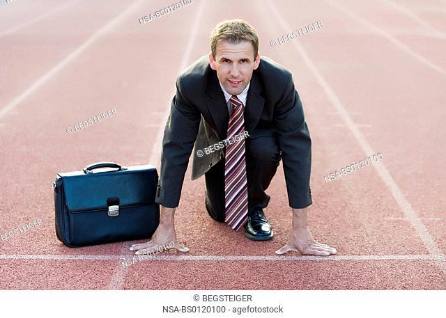 businessman at starting line