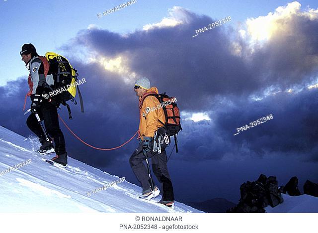 Climbing team ascending ridge in late evening, Mont Blanc-area, Chamonix, France