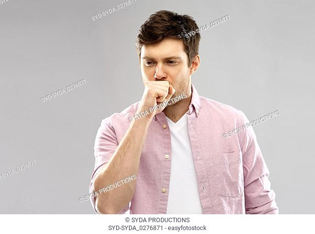 unhealthy young man coughing