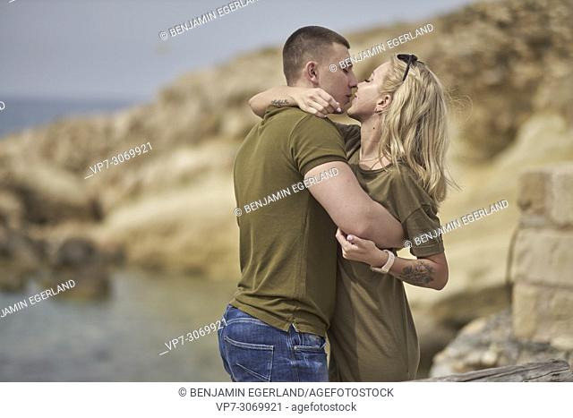 Young couple kissing, Russian ethnicity, Hersonissos, Crete, Greece