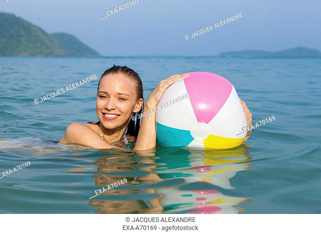 Woman with ball swimming