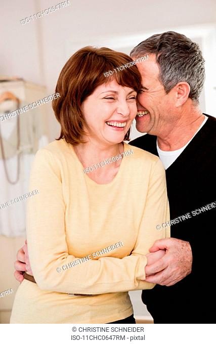 Eldery couple embracing and laughing