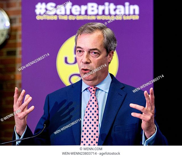 UKIP leader Nigel Farage brandishes a Passport during his keynote speech on how, he believes, the UK will be safer from Daesh and other Jihadi terrorists if the...