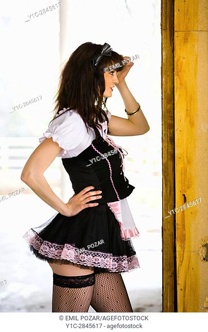 French-maid fixing hair