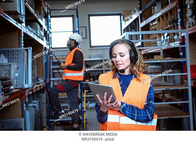 Female worker using digital tablet