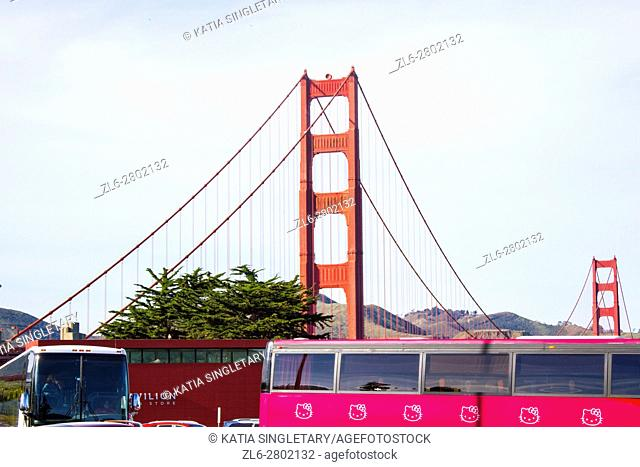 Many tourist buses parked at the parking of the Golden Gate Bridge, USA, California, San Francisco, with the view of Golden Gate Bridge in the background
