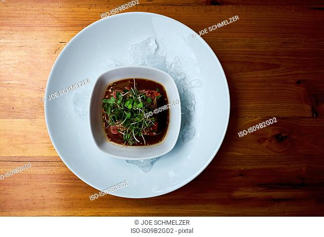 Overhead view of bowl of fresh soup on ice, Antigua, Guatemala