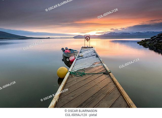 Boat and pier at sunset, Hvalfjordur, Iceland