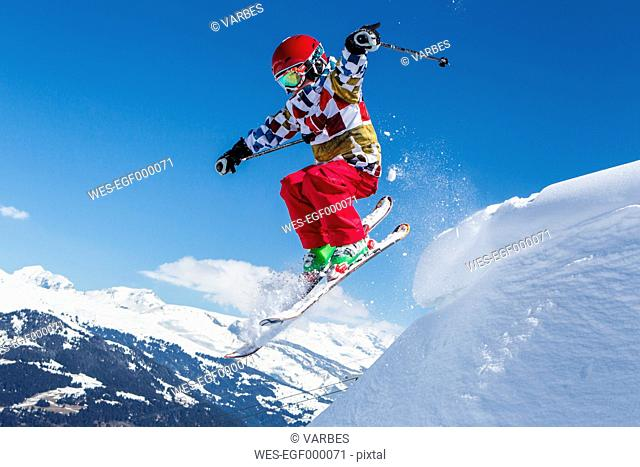 Switzerland, Grisons, Obersaxen, Boy on the slope