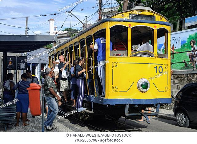 Bonde, Rio's famous electric tram at the stop Largo do Guimaraes; Rio de Janeiro, Espirito Santo, Brazil. The historic street railway has been transporting Rio...