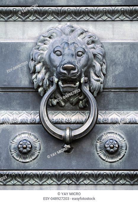 Old lion head door knocker monochrome toned