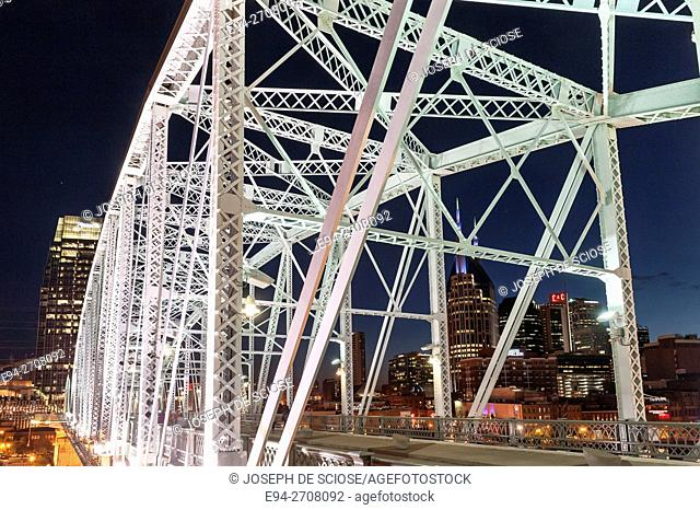 A night photograph of the Shelby Street Bridge with the Nashville (Tennessee, USA) skyline in the background