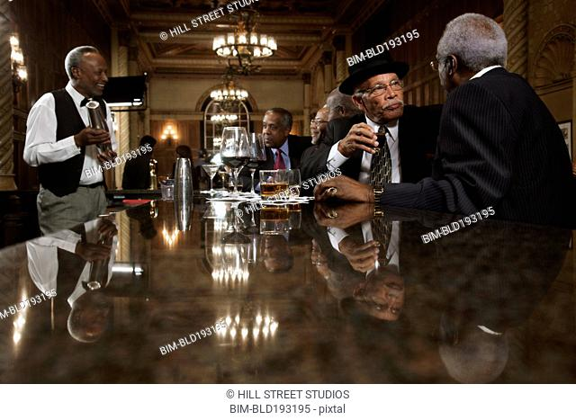 African American men drinking at bar