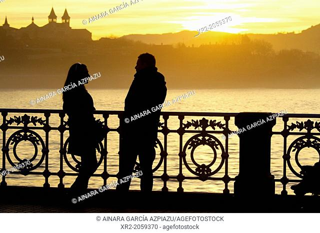 Couple in a romantic sunset in Donostia - San Sebastian, Basque Country, Spain