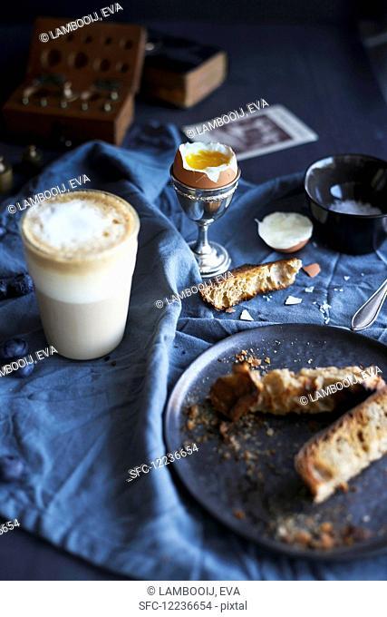Soft boiled egg and latte