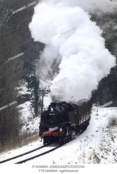 BR Standard 4 Tank heads through the snow into Highley, Severn Valley Railway, Shropshire, England, Europe