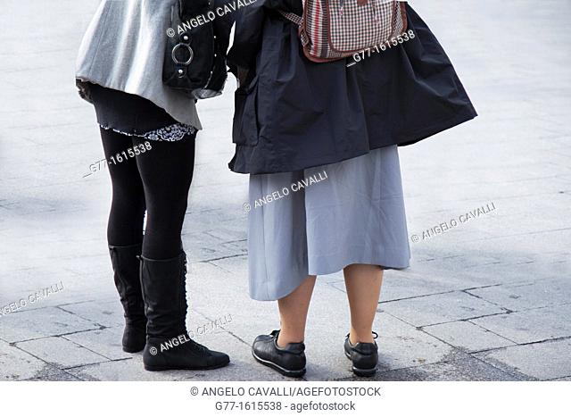 Nun and young lady in Plaza Mayor, Madrid, Spain
