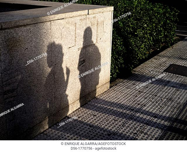 Shadow of two persons talking, Valencia, Spain