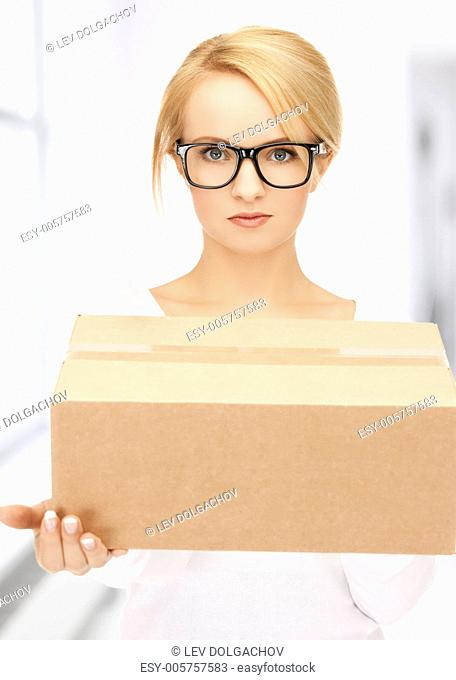 picture of young woman with cardboard box
