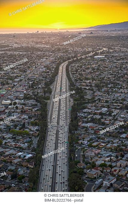 Aerial view of highway in suburban cityscape